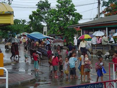 Cambodian children on Thai border begging in rain