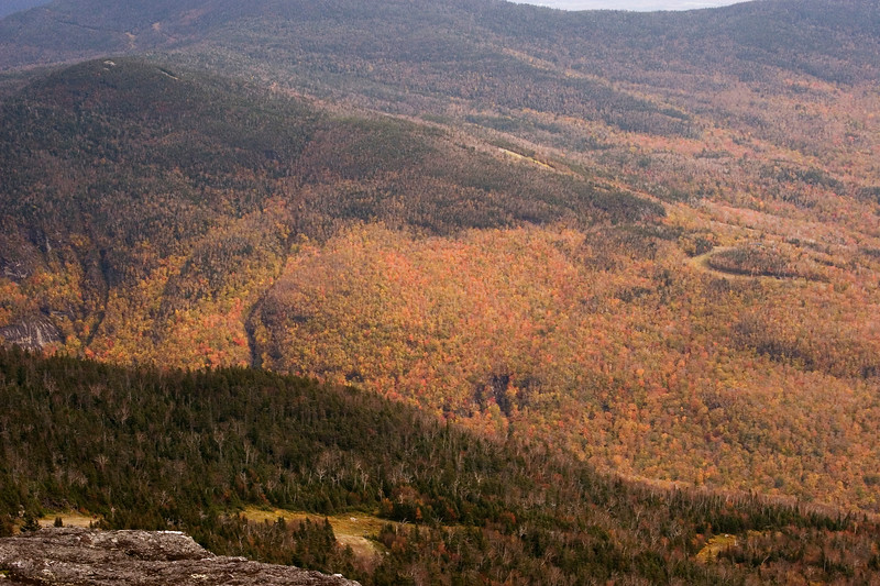 Fall color on the mountains below.