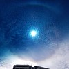 another shot of the full rainbow around the sun in Quito as shot through the driver's vehicle's windshield