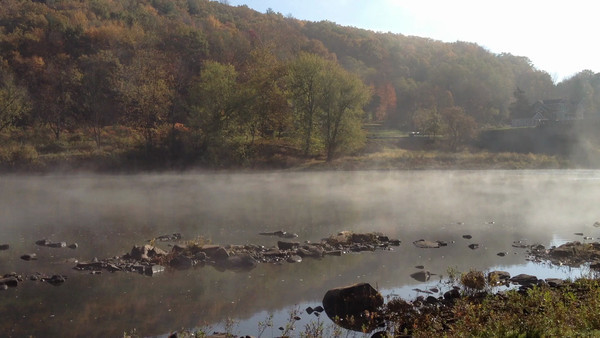 Mist rolling across the river