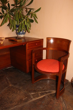 In the guest house bedroom, Wright-designed desk and barrel chair