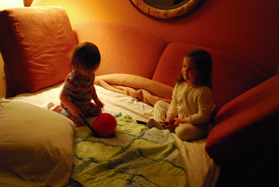"The girls playing ""roll the pumpkin"" on (one of) the bed(s) at the resort"