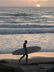 Surfer at sunset, point and shoot camera, San Diego, California.