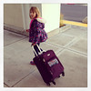 Keira picking up her new purple suit case from Khols for our trip.
