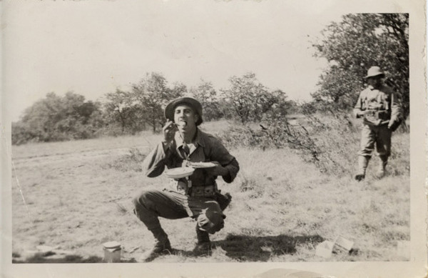 Frank Hajik eating in the field when in the Army