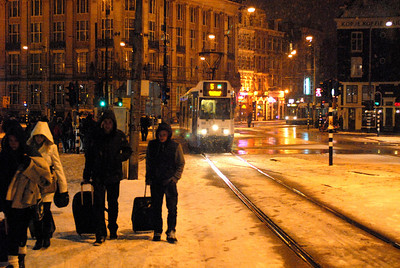 Night scene in front of Amsterdam's central train station.
