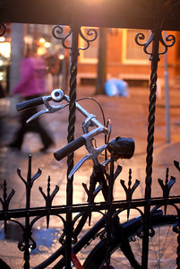 A bicycle chained to the fence outside of the Riks museum ...