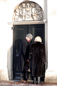 A couple entering the side door of Westkirk.