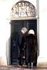 A couple entering the side door of Westkirk.