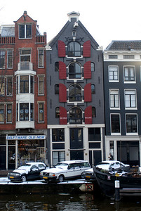 Interesting shutters on a building across the canal from Anne Frank's house.  Most of these were built in the 1600's - on 45-foot logs that were driven into the soft mud to support them.  Many of them lean forward - for two reasons (according to the canal boat tour guide) - one is to make them look larger, the other is to keep furniture away from the front of the house as it is hoisted up and down when people move.