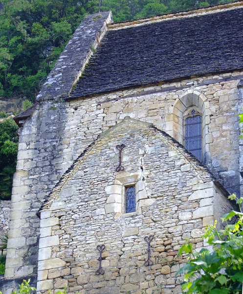 Old stonework of the church.  The metal ornaments are connected to rods to hold the church together.