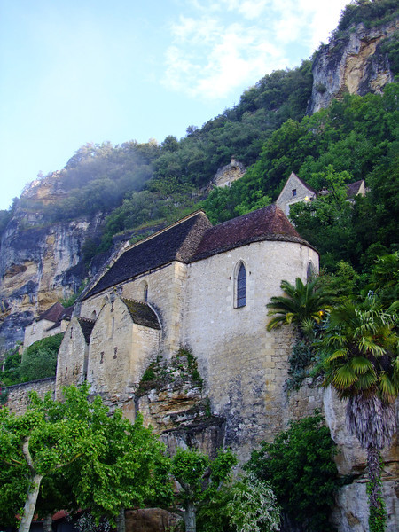 The very old Catholic Church perched along the rocky cliff.