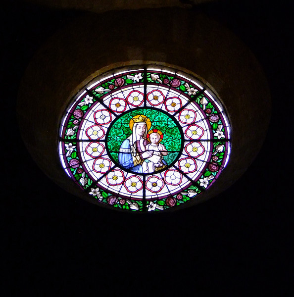 Stained glass within the church at Domme.