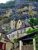 Homes beneath the steep rocky cliffs of the village of La Roque Gageac.