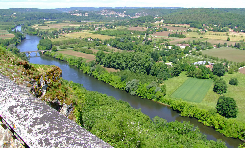 A view of the Dordogne River valley from Domme.  The rocky cliffs of the village of La Roque Gageac are in the background.
