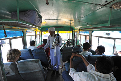 Bus ride from Agra to Fatehpur Sikri which is located about 40 km from the Taj Mahal.  Fatehpur Sikri (Hindi: फतेहपुर सीकरी, Urdu: فتحپور سیکری) is a city and a municipal board in Agra district in the state of Uttar Pradesh, in North India. The historical city was constructed by Mughal Emperor Akbar beginning in 1570 and served as the empire's capital from 1571 until 1585. Though it took 15 years to build, it was abandoned after only 14 years of use because of shortage of water supply which was unable to sustain the growing population. The palace and mosque in Fatehpur Sikri are a tourist attraction and it is an UNESCO World Heritage Site. Uttar Pradesh state (UP), North India.