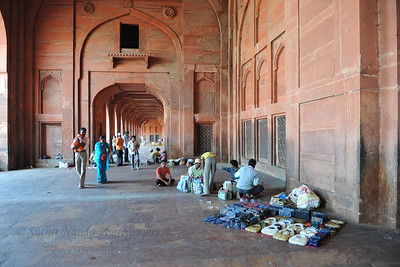 Buland Darwaza: One of the gateways to the Jama Masjid, is a stupendous piece of architecture.   Fatehpur Sikri (Hindi: फतेहपुर सीकरी, Urdu: فتحپور سیکری) is a city and a municipal board in Agra district in the state of Uttar Pradesh, in North India. The historical city was constructed by Mughal Emperor Akbar beginning in 1570 and served as the empire's capital from 1571 until 1585. Though it took 15 years to build, it was abandoned after only 14 years of use because of shortage of water supply which was unable to sustain the growing population. The palace and mosque in Fatehpur Sikri are a tourist attraction and it is an UNESCO World Heritage Site which is about 40 km from the Taj Mahal, Agra. Uttar Pradesh state (UP), North India.