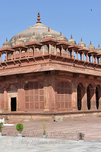 Jama Masjid: The mosque, built in the manner of Indian mosques, with liwans around a central courtyard. A distinguishing feature is the row of chhatri over the sanctuary.   Fatehpur Sikri (Hindi: फतेहपुर सीकरी, Urdu: فتحپور سیکری) is a city and a municipal board in Agra district in the state of Uttar Pradesh, in North India. The historical city was constructed by Mughal Emperor Akbar beginning in 1570 and served as the empire's capital from 1571 until 1585. Though it took 15 years to build, it was abandoned after only 14 years of use because of shortage of water supply which was unable to sustain the growing population. The palace and mosque in Fatehpur Sikri are a tourist attraction and it is an UNESCO World Heritage Site which is about 40 km from the Taj Mahal, Agra. Uttar Pradesh state (UP), North India.