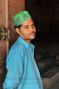 Person who helps those who come pray at the tombs at Fatehpur Sikri. Fatehpur Sikri (Hindi: फतेहपुर सीकरी, Urdu: فتحپور سیکری) is a city and a municipal board in Agra district in the state of Uttar Pradesh, in North India. The historical city was constructed by Mughal Emperor Akbar beginning in 1570 and served as the empire's capital from 1571 until 1585. Though it took 15 years to build, it was abandoned after only 14 years of use because of shortage of water supply which was unable to sustain the growing population. The palace and mosque in Fatehpur Sikri are a tourist attraction and it is an UNESCO World Heritage Site which is about 40 km from the Taj Mahal, Agra. Uttar Pradesh state (UP), North India.
