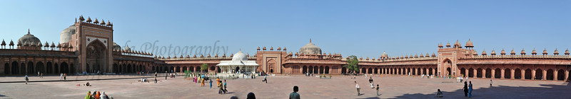 Panoramic view of the tomb of Salim Chisti at Jama Masjid. A white marble encased tomb within the Jama Masjid's courtyard is the Tomb of Salim Chisti - the sufi saint who lived as a recluse in the small town Sikri near Agra.  Fatehpur Sikri (Hindi: फतेहपुर सीकरी, Urdu: فتحپور سیکری) is a city and a municipal board in Agra district in the state of Uttar Pradesh, in North India. The historical city was constructed by Mughal Emperor Akbar beginning in 1570 and served as the empire's capital from 1571 until 1585. Though it took 15 years to build, it was abandoned after only 14 years of use because of shortage of water supply which was unable to sustain the growing population. The palace and mosque in Fatehpur Sikri are a tourist attraction and it is an UNESCO World Heritage Site which is about 40 km from the Taj Mahal, Agra. Uttar Pradesh state (UP), North India.