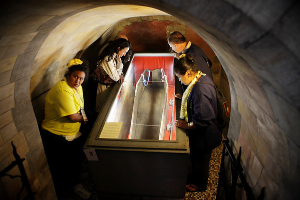 Members of the Hawaii contingent view the coffin that brought Father Damien back to Flanders in the Damiaan Museum (Damien's former home) in Ninde, a hamlet of Tremelo, Belgium on October 3, 2009.