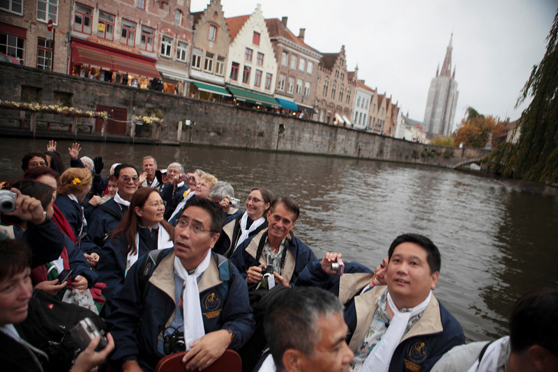 Calvin Liu, Robert Mondoy, and other members of the choir representing the parishes of Hawaii, admire the buildings along the canals of Bruges, Belgium on October 5, 2009.