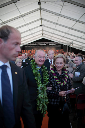 King Albert II and Queen Paola of Belgium, adorned by lei from Hawaii, attend a mass for Father Damien in Tremelo, Belgium on October 3, 2009.
