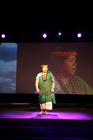 A member of Keali'ika'apunihonua Ke'ena A'o Hula performs an oli at a performance celebrating the life of Father Damien in Tremelo, Belgium on October 4, 2009.