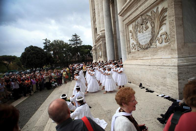 The Hawaii halau dances a hula outside the Basilica of St. John Lateran in Rome, Italy on October 12, 2009.