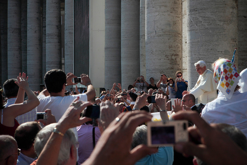 Pope Benedict XVI makes his way through the crowd before St. Peter's Basilica before the canonization of Father Damien on October 11, 2009.