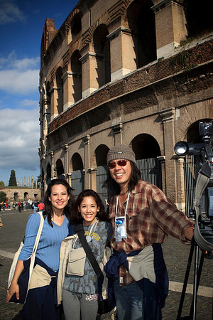 Members of Hawaii's media accompanying the Hawaii tour for Father Damien's canonization pose for a shot in front of the Colosseum in Rome, Italy on October 10, 2009.