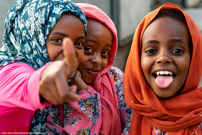 ##22A and 22B – Harar, Ethiopia.  Young girls tease me as I try to take their picture!