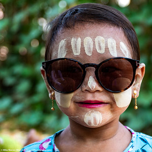 ##26A and 26B – Outside Bagan, Myanmar.   A young girl wears traditional Thanakha face paint in a small village rarely visited by foreigners.