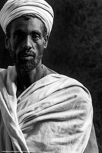 ##18A and 18B – Lalibela, Ethiopia.  A priest at of the rock hewn churches of Lalibela Ethiopia.  These churches, carved from solid rock centuries ago, are every bit as spectacular as the gothic cathedrals of Europe.