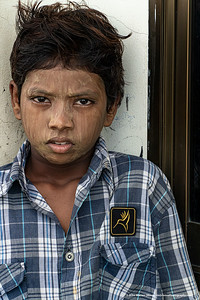 #21 – Yangon, Myanmar.  Portrait of a young man in the largest city of Myanmar.