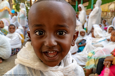 #4 – Gondor, Ethiopia.  This image was taken at a church service outside the town, when a friendly young boy ran up to meet the white foreigners.