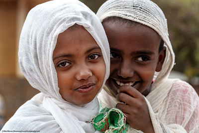 ##25A, 25B and 25C – Gondor, Ethiopia.   Church goers dressed in white, head to Church, and in the case of the kids, pose for pictures.