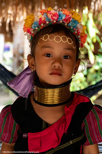 "##17A and 17B – Outside Chiang Rai, Thailand.   Young girls of the Kayan or Karen villages in northern Thailand (also found in Myanmar) wear the traditional brass neck rings of the ""Long Neck Women."""