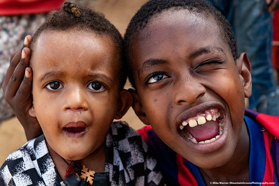 #15 – Jinka, Ethiopia.  Two boys clown for the camera.