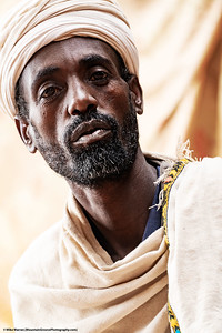 ##18A and 18B – Lalibela, Ethiopia.  A priest at one of the rock hewn churches of Lalibela Ethiopia.  These churches, carved from solid rock centuries ago, are every bit as spectacular as the gothic cathedrals of Europe.