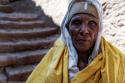 ##19A and 19B – Lalibela, Ethiopia.  An elderly woman at one of the rock hewn churches of Lalibela Ethiopia.  The people of the Ethiopian Highlands are devoutly Christian.