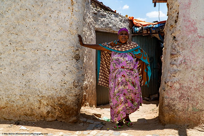 #20 – Harar, Ethiopia.  An older woman in the walled city of Harar.  The travel writer, Paul Theroux, called Harar the least hospitable place he had ever visited (and thus he stayed for 2 weeks!).  I found Harar, often called the 4th most holiest city for Muslims, to be friendly and photogenic!