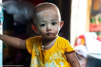 ##16A and 16B – Nyaung-U, Myanmar.  A young child wears the traditional Thanakha face paint found on most women and children, and some men, in Myanmar.