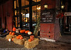 Vitale's fruit and vegetable stand at the Old Market, downtown Omaha. Naturally diffuse lighting on a fall rainy day helps to enrich this scene.