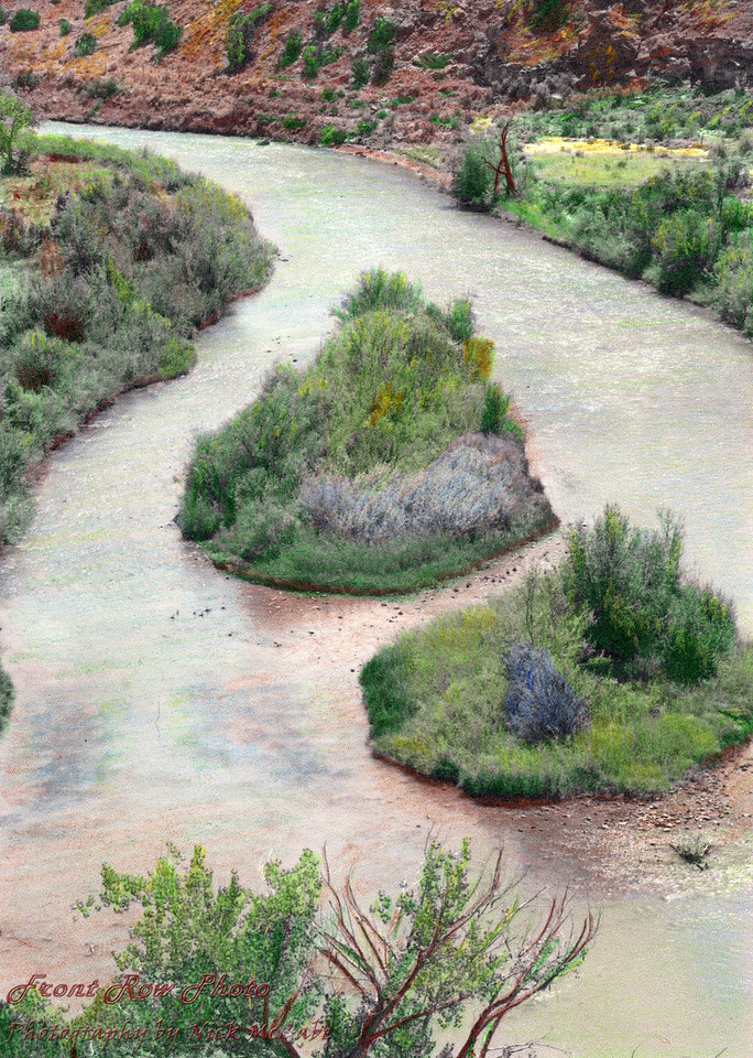 This is a hand colored version of the previous picture.<br /> This is a black and white photograph which I colored with pencils. It is a river in the Abiqui area of New Mexico.