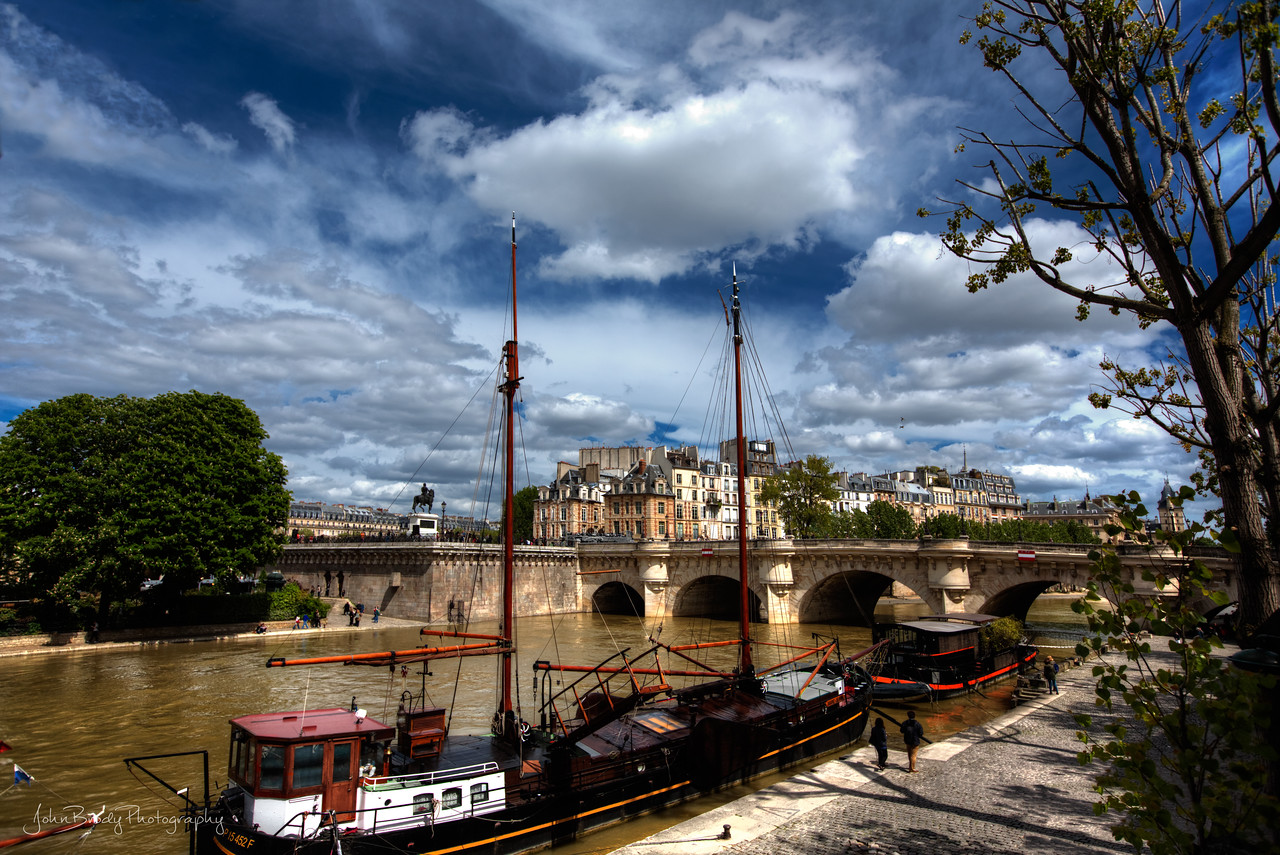 Schooners Moored At Pont Neuf Paris. A Favorite Gathering Place For Young Locals, this bridge is a perfect place for travel, art, fashion and other beautiful photography - John Brody Photography / JohnBrodyPhotography.com / JohnBrody.com