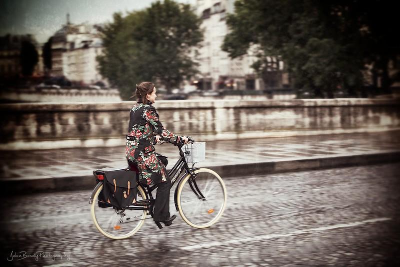 Girl on Bicycle - Pont Neuf Bridge, Paris, France - JohnBrody.com / John Brody Photography