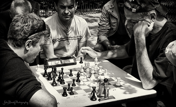 Intense game of chess at Luxemburg Gardens in Paris - Furrowed brows and dead silence. The gent at left won with only 3 seconds left...  JohnBrody.com / John Brody Photography