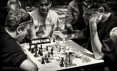 Intense game of chess at Luxemburg Gardens in Paris - Furrowed brows and dead silence - JohnBrody.com / John Brody Photography