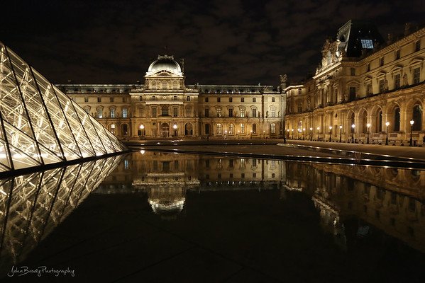 Louvre Museum And Pool Reflection. Louvre Museum Paris  -  Always beautiful, the cloudless skies and the lack of crowds made this a stop and shoot moment. The visuals really seemed to 'pop' this night. This scene was as beautiful as the Mona Lisa inside  - JohnBrody.com / John Brody Photography